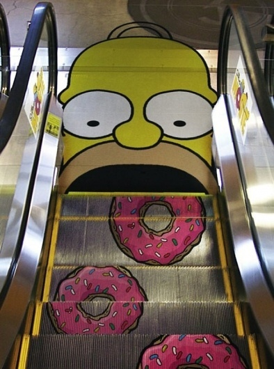 homer eats some donuts on the escalator - technabob #simpsons