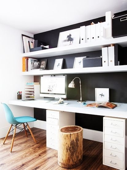 black and white office with white magazine files