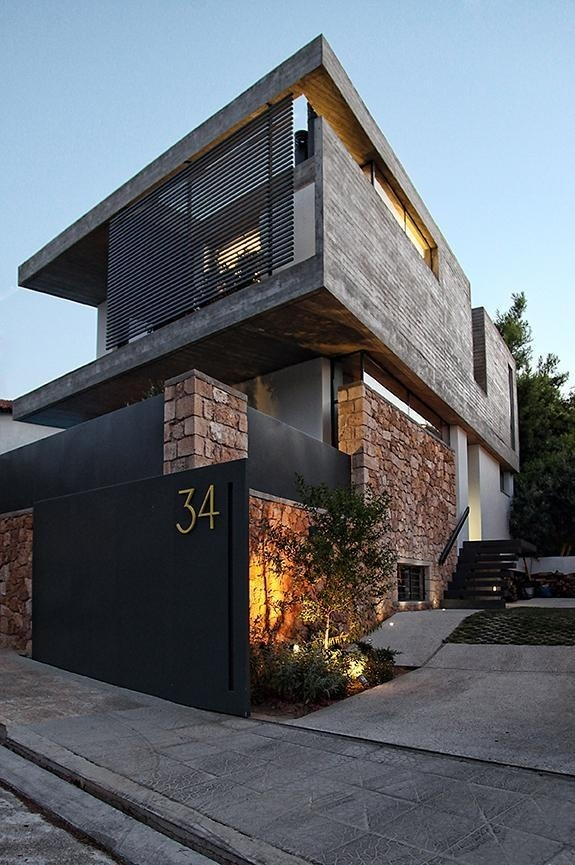 Sleek Athens House Blends Stone by WoARCHITECTS #architecture