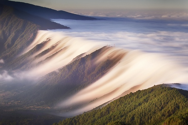 A Waterfall of Clouds on the Canary Islands #clouds #sunset #mountains #waterfall