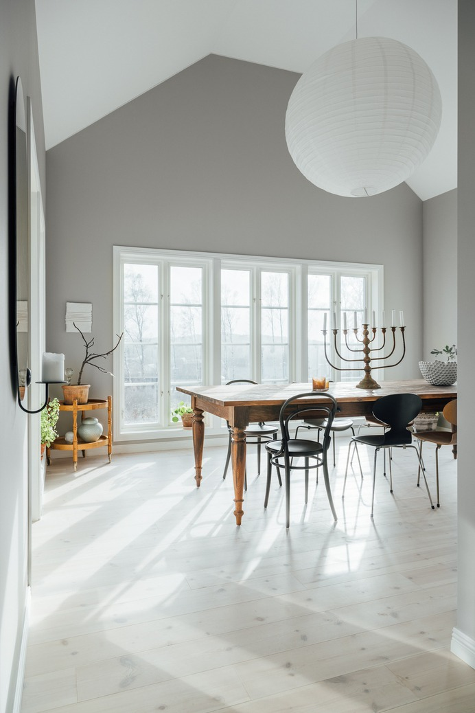 The wide-planked pine flooring extends into the dining room, just off the kitchen.