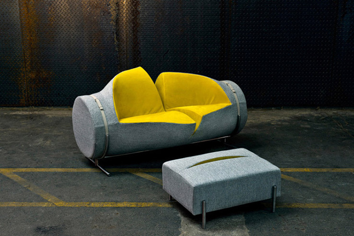 This unique sofa and ottoman looks as though it has been slashed with a knife. #design #product #furniture